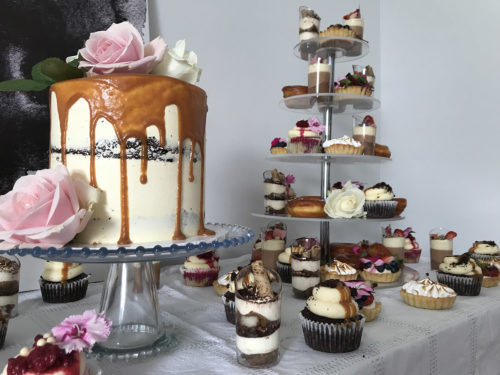 Cakes on a dessert table at a wedding