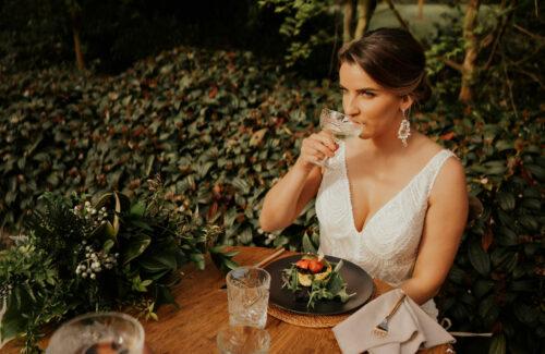 Glamorous bride sitting at dinner table